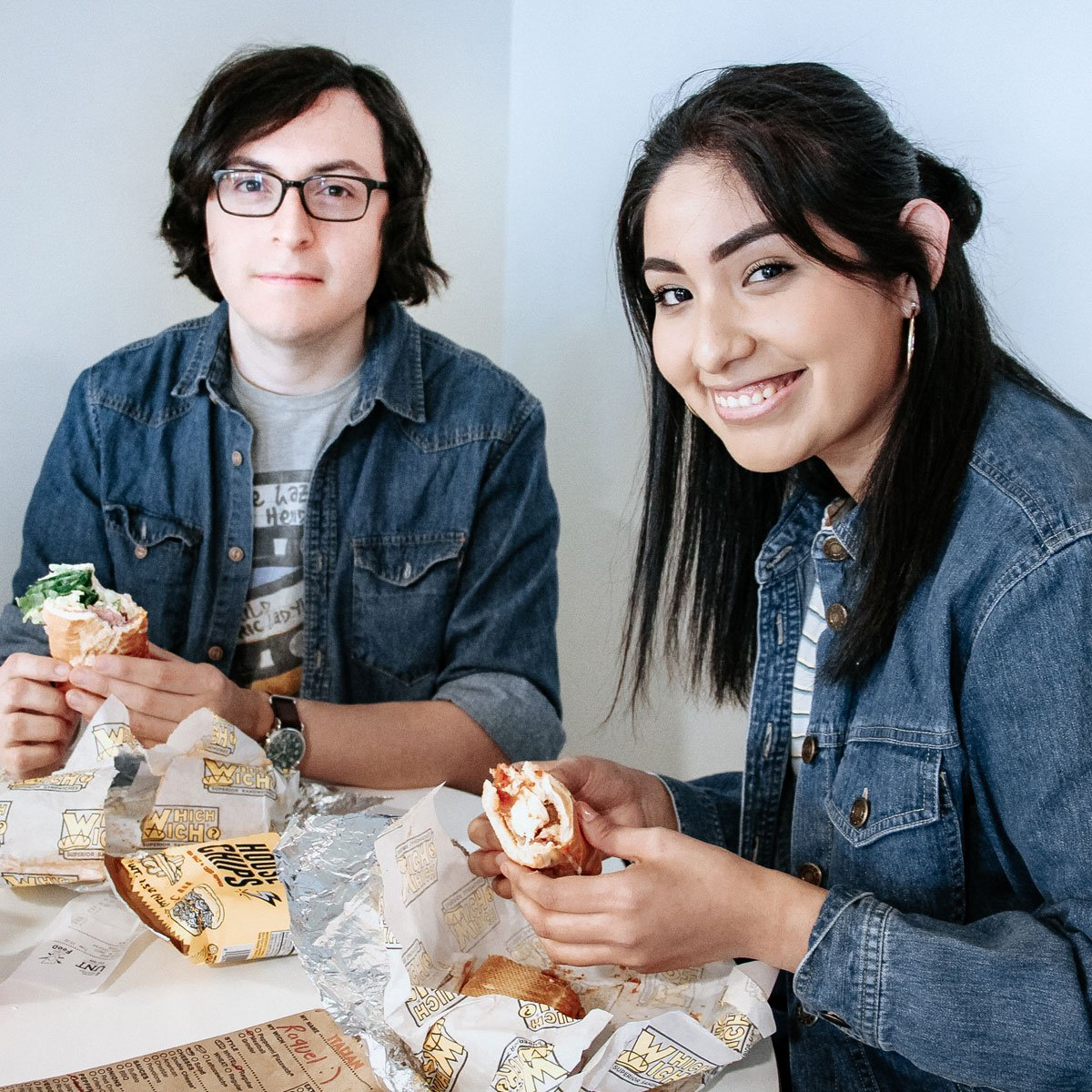 Two students enjoying Which Wich sandwiches in the Union