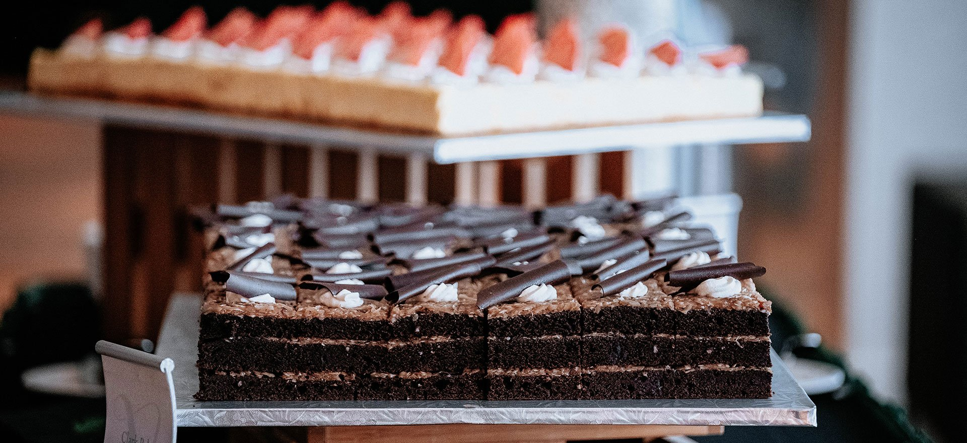 German chocolate cake sheet and cheesecake sheet at a catering event