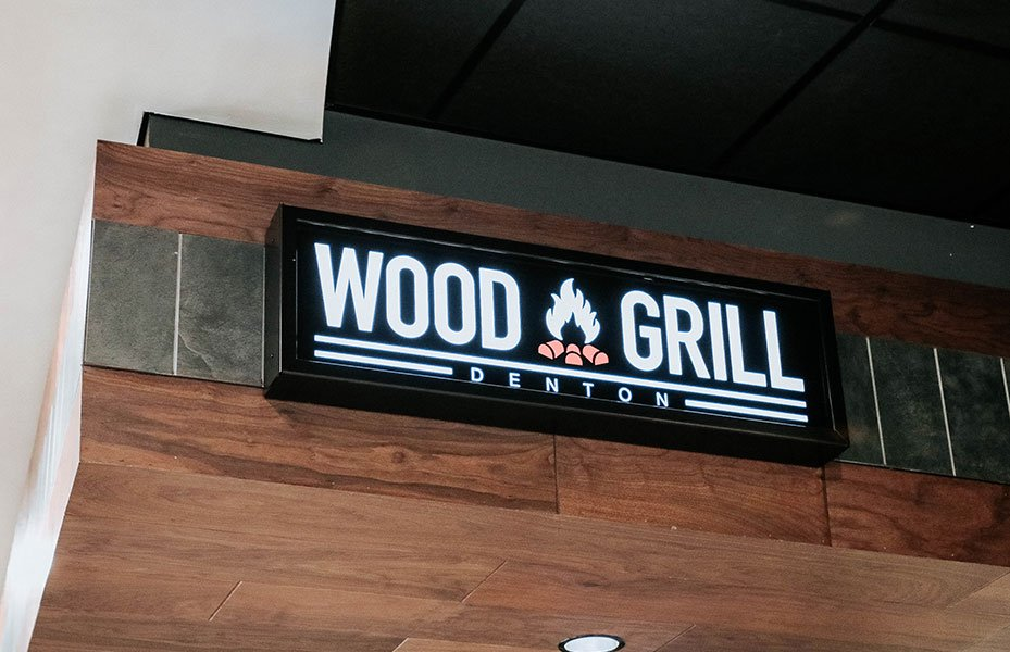 Wood Grill logo in Eagle Landing